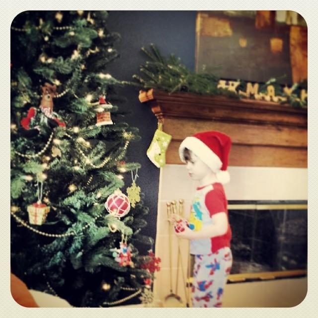 Santa Max decorates the tree