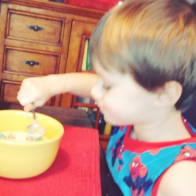 Happily eating cereal.