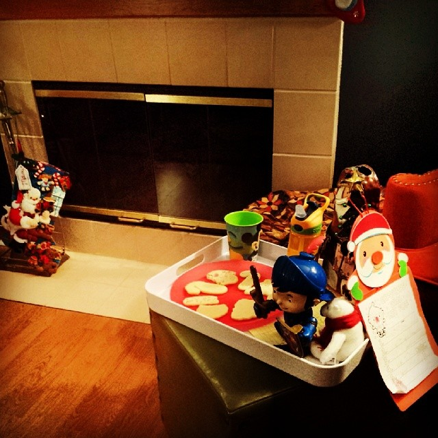 "Santa is treated well at Max's house: Milk, cookies, water, statue of honor, gift request list, ""thank you"" note, polar bear gift, & Mike the Knight to guard it all."