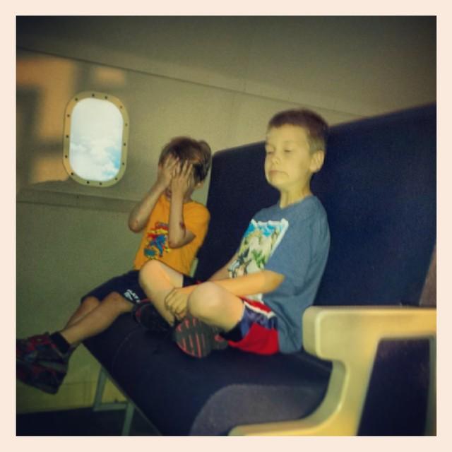 Max & Gabe enjoying their flight to China.
