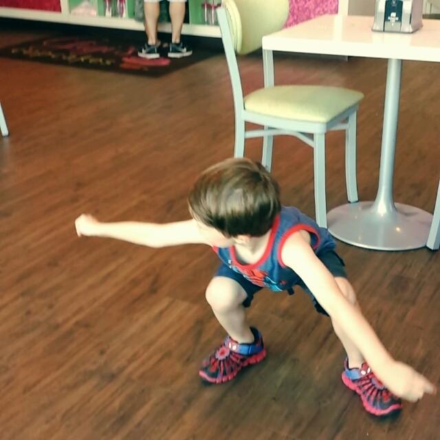 Max practices kung-fu at Gigi's Cupcakes