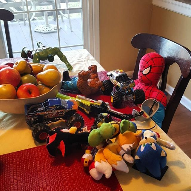 Not exactly sure how this happens. They don't arrive at once. It's just one toy at a time until - all of a sudden - the table's covered in toys and Spiderman's to blame.