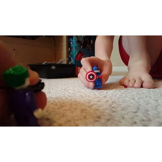 Joker fires at Captain America's shield.